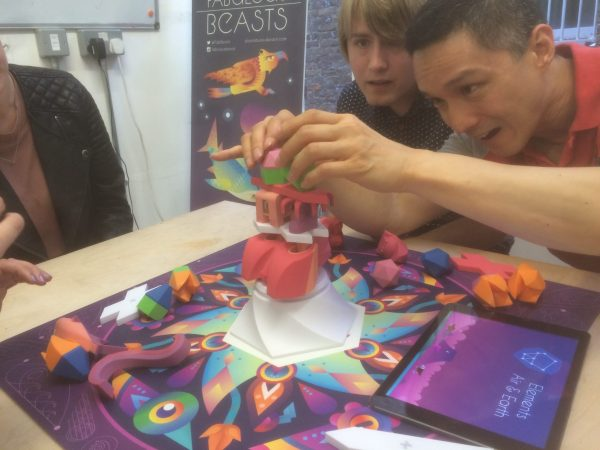 Beasts of Balance stacking game being played at an event in London 2