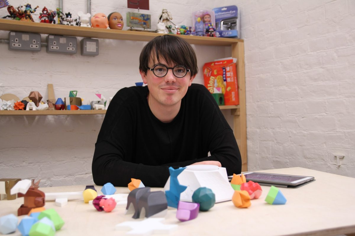 George from the Beasts of Balance team with a plinth and stackable objects